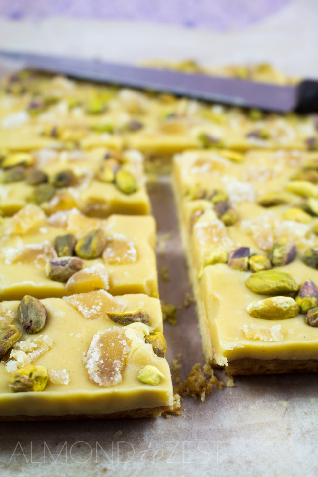 Ginger and Pistachio Slice - Full of crunch and spice with a rich silky frosting that melts in your mouth! This is sure to be a favorite!!
